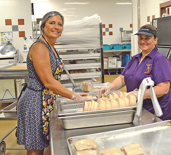Charlotte County food service worker Kat Mims with a local reporter